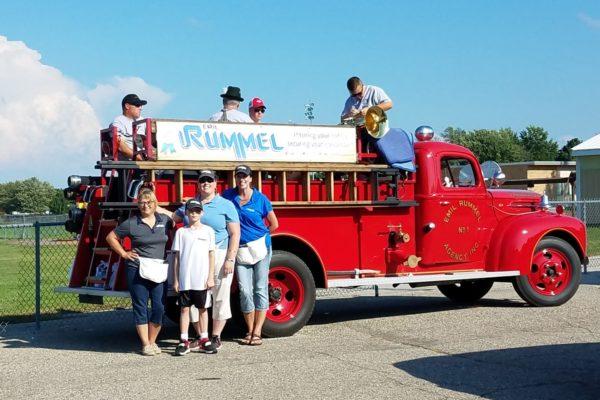 Riverfest Parade Vassar Team with Firetruck