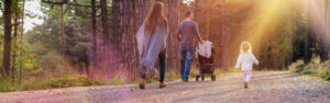 Header - Life Insurance Landing Page Family Walking Down a Wooded Path